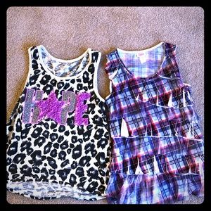 Two Justice girls layering tanks